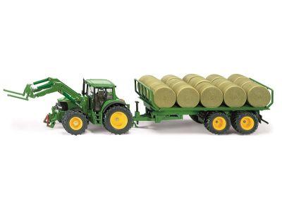 John Deere Traktor 6820 mit Anhänger und Rundballen